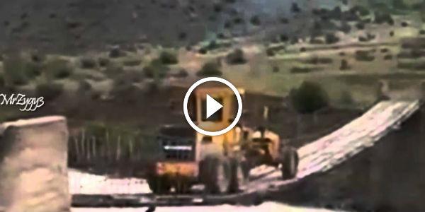 tractor crossing bridge
