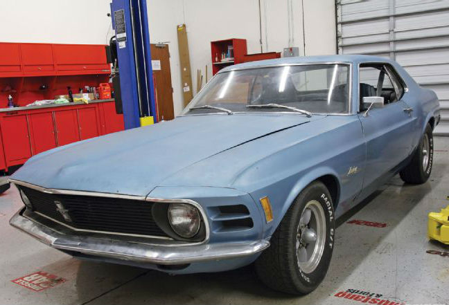 mdmp_1104_03_o+1970_ford_mustang_project_high_school_hauler+driver_side_front
