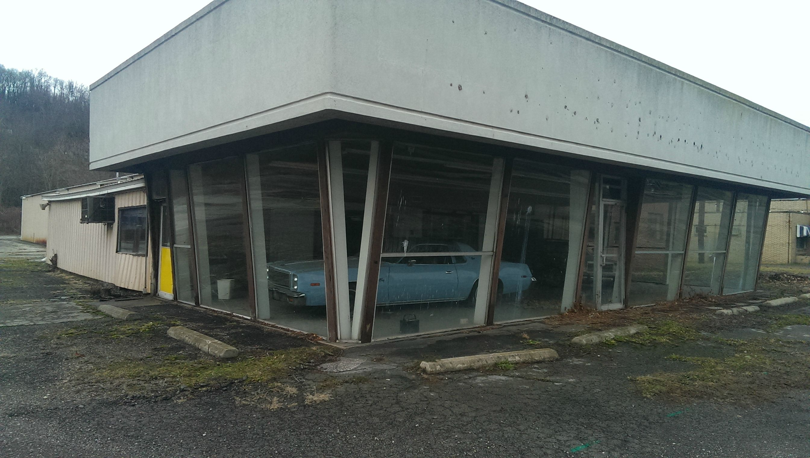 Abandoned vehicles as dealerships ran out of business East motors