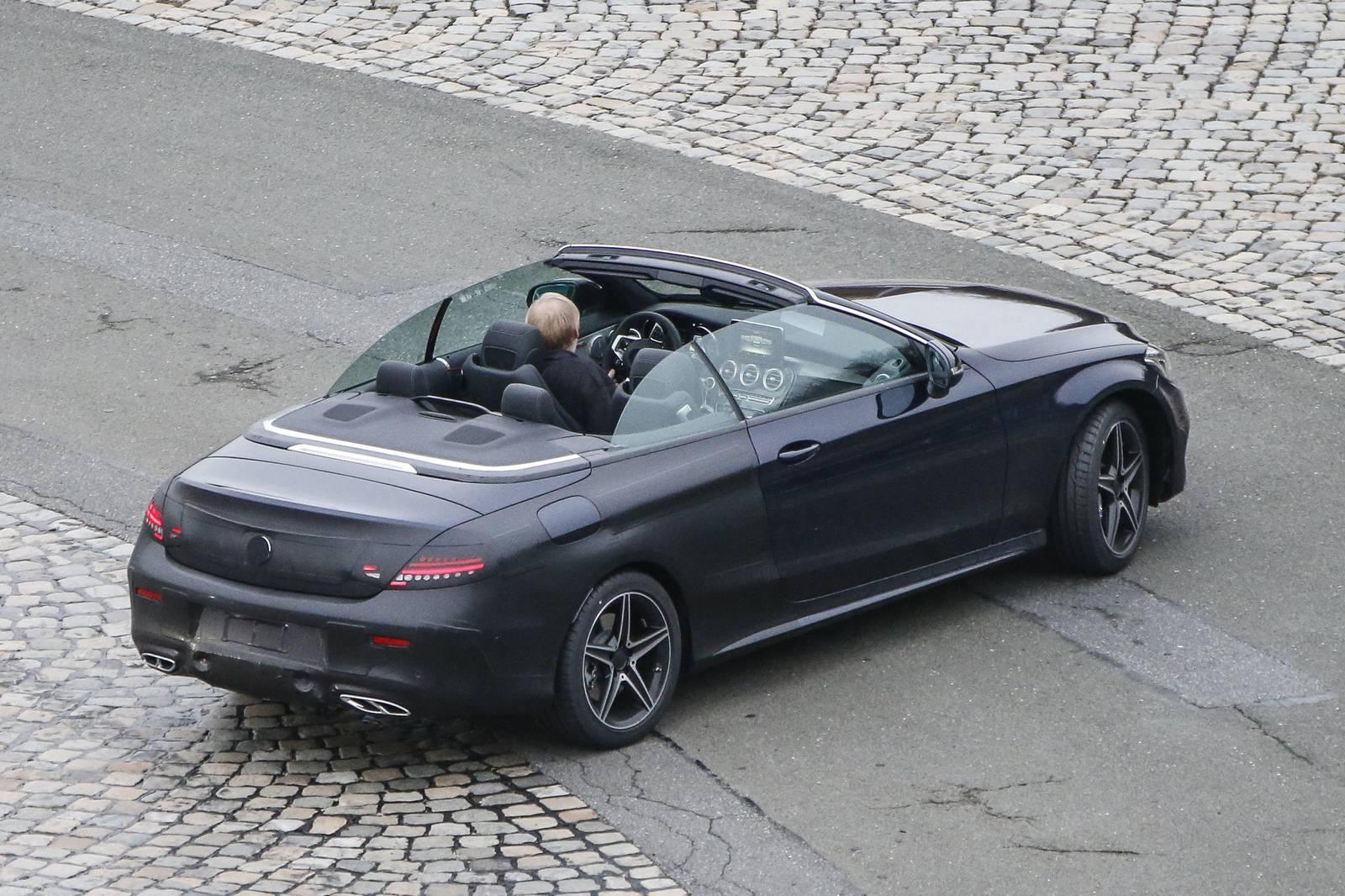 Spy images from drop top 2017 new mercedes c class for Drop top mercedes benz prices