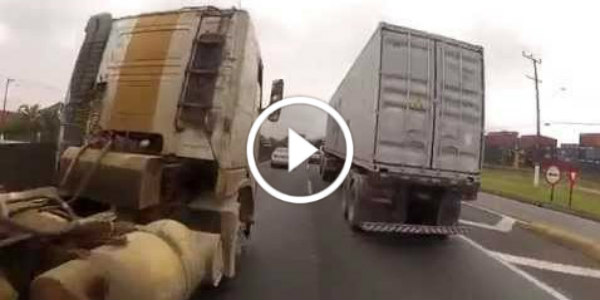 crazy motorcycle rider sao paolo between trucks 5