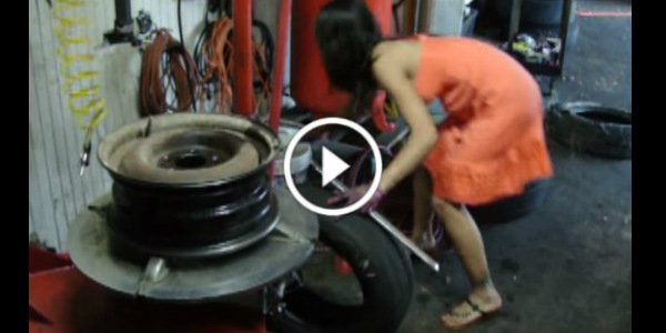 the ideal gearhead wife   car tire change by an asian lady