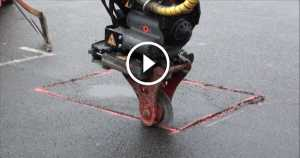 road-machine-cuts-the-asphalt