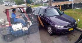 workers moved parked car forklift 1