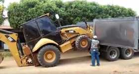 Park Dozer Cat 416 In A Truck Without A Ramp 1
