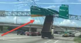 Dump Truck Driver Lifted Trailer Destroys Highway Signs crash 2